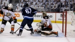 Winnipeg Jets' Tyler Myers (not shown) scores on Anaheim Ducks goaltender Frederik Andersen with Ducks' Simon Despres and Jets' Michael Frolik in front of the net during the second period of game three NHL playoff hockey action in Winnipeg on April 20, 2015. (Trevor Hagan / THE CANADIAN PRESS)