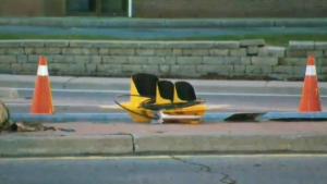 A traffic light lies on the ground following a crash in Brampton on Tuesday, April 21, 2015.