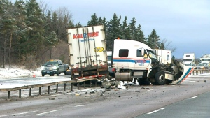 A woman is dead following a crash between a vehicle and tractor-trailer on northbound Highway 400 near Highway 89.
