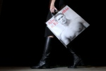 A shopper carries her Abercrombie & Fitch purchase in Phoenix in this Nov. 14, 2011, file photo. (AP / Ross D. Franklin)