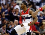 Washington Wizards guard John Wall (2) celebrates after a basket during the first half of Game 3 in the first round of the NBA basketball playoffs against the Toronto Raptors on April 24, 2015, in Washington. (Alex Brandon / AP Photo)