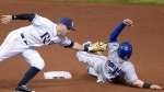 Toronto Blue Jays' Josh Donaldson (20) steals second base past the tag of Tampa Bay Rays third baseman Evan Longoria, who was playing the shift, during the sixth inning of a baseball game in St. Petersburg, Fla., Saturday, April 25, 2015.(AP Photo/Phelan M. Ebenhack)