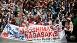 Survivors of the nuclear attacks on Japan in 1945 participate in an anti-nuclear rally in Union Square in New York, Sunday, April 26, 2015. This year marks the 70th anniversary of the United States using nuclear bombs on Hiroshima and Nagasaki in Japan. (AP Photo/Seth Wenig)