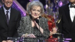 Betty White accepts the lifetime achievement award at the 42nd annual Daytime Emmy Awards at Warner Bros. Studios in Burbank, Calif. on Apr. 26, 2015. (Chris Pizzello / Invision)