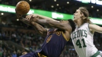 Cleveland Cavaliers guard Iman Shumpert drives toward the basket as Boston Celtics centre Kelly Olynyk, right, reaches for the ball in the fourth quarter of a first-round NBA playoff basketball game in Boston on April 26, 2015. (AP / Steven Senne)