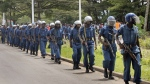 Burundian riot police patrol following clashes with opposition protesters in a street in the capital Bujumbura, Burundi on April 26, 2015. Hundreds of people in Burundi protested in the capital Sunday after the country's ruling party nominated President Pierre Nkurunziza to run for a third term. (AP / Eloge Willy Kaneza)