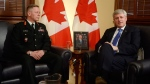 Lt.-Gen. Jonathan Vance, left, poses for a photo with Prime Minister Stephen Harper in Ottawa on Monday, April 27, 2015. (Adrian Wyld / THE CANADIAN PRESS)