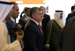 King Abdullah of Jordan arrives at an economic conference seeking billions of dollars in investment that brings together hundreds of business executives and foreign leaders, in Sharm el-Sheikh, Egypt, Friday, March 13, 2015. (AP Photo/Hassan Ammar)