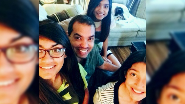 This undated photo shows Dennis Bahadur and his three daughters between the ages of 11 and 16.