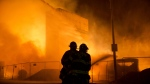Firefighters battle a blaze after rioters plunged part of Baltimore into chaos, torching a pharmacy, setting police cars ablaze and throwing bricks at officers on Monday, April 27, 2015. (AP / Matt Rourke)