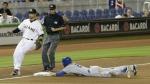 New York Mets' Eric Campbell steals third base as Miami Marlins third baseman Martin Prado awaits the throw in the ninth inning of a baseball game in Miami on April 27, 2015. (AP / Alan Diaz)