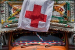 A Nepalese truck with a Red Cross flag drives through the streets of Kathmandu, Nepal on Sunday, May 3, 2015. (AP / Bernat Amangue)