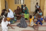 Women and children rescued by Nigerian soldiers wait to receive treatment at a refugee camp in Yola, Nigeria Sunday, May 3, 2015, after being rescued from captivity by Boko Haram fighters. ( AP/Sunday Alamba)