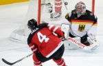 Canada's Taylor Hall, left, scores his third goal of the game past Germany's Danny aux den Birken, right, during the Hockey World Championships Group A match in Prague, Czech Republic on Sunday, May 3, 2015. (AP / Petr David Josek)