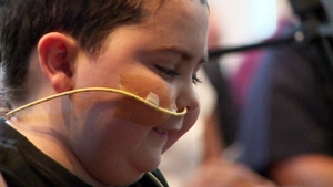 Boy battling cancer follows in family's footsteps