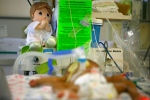 An angel doll and list of health precautions for visitors are seen by a premature baby sleeping in the neonatal intensive care unit at The Medical Center on May 11, 2010. (AP / Ricardo Arduengo)