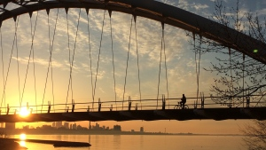 Take a break from the hustle and bustle of the big city to step back and admire its beauty. CTV News photojournalist George Stamou turns his lens on Toronto to capture daily life across our city.<br><br> A person rides a bike across the Humber Bay bridge in Toronto on Wednesday, May 6, 2015. (George Stamou / CTV Toronto)