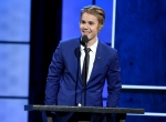 Justin Bieber speaks at the Comedy Central Roast of Justin Bieber at Sony Pictures Studios, in Culver City, Calif., March 14, 2015. (Chris Pizzello / Invision / AP)