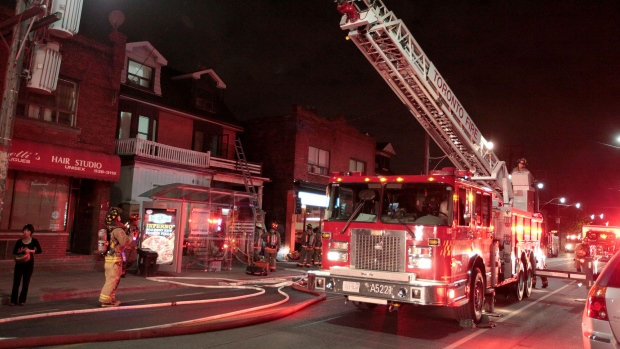 Firefighters and police are on scene of a blaze on Dupont Street in Toronto on Sunday, May 17, 2015. (John Hanley)
