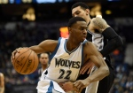 In this Jan. 10, 2015, file photo, Minnesota Timberwolves forward Andrew Wiggins (22) drives against San Antonio Spurs guard Danny Green (14) during the fourth quarter of an NBA basketball game in Minneapolis. (/Hannah Foslien / AP Photo)