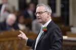 International Trade Minister Ed Fast rises during Question Period in the House of Commons in Ottawa, Wednesday, May 6, 2015. Trade talks have stalled between Canada and Japan -- one of the Harper government's priority countries for a breakthrough -- because the Asian country has lost interest, The Canadian Press has learned. (Adrian Wyld / THE CANADIAN PRESS)