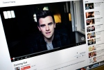 """This Wednesday, May 20, 2015 photo shows, Connor Franta's """"Coming Out"""" video playing on YouTube displayed on a computer screen in Los Angeles. YouTube, which is celebrating its 10th anniversary throughout May, has in recent years propped up YouTubers like Franta - """"creators,"""" the site calls them. (AP/Richard Vogel)"""