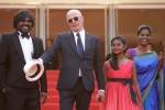 From left, Jesuthasan Antonythasan, director Jacques Audiard, Claudine Vinasithamby and Kalieaswari Srinivasan pose for photographers upon arrival for the screening of the film 'Dheepan' at the Cannes Film Festival on Thursday, May 21, 2015. (AP / Lionel Cironneau)