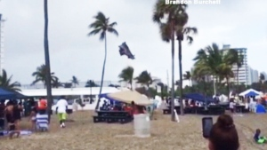 Extended: Waterspout lifts bounce house