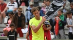 Vasek Pospisil leaves the court after losing to Joao Sousa during their first round match at the French Open, on May 26, 2015 in Paris. (AP / David Vincent)