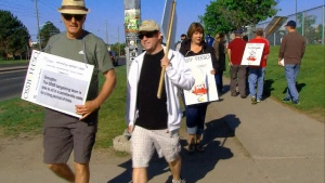 A group of teachers are seen picketing on Tuesday, May 26, 2015.