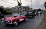 In this photo taken May 10, 2015, people drive their classic cars, on a street in Karachi, Pakistan. (AP Photo/Shakil Adil)