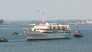 Captain John's is towed into Lake Ontario on Thursday, May 28, 2015.