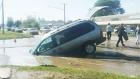 CTV Saskatoon: Van falls into flooded sinkhole
