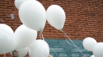 Officials let go of 39 white balloons, representing the victims, during a commemoration at the King Boudouin (formerly the Heysel) Stadium in Brussels on May 29, 2015. (AP / Virginia Mayo)