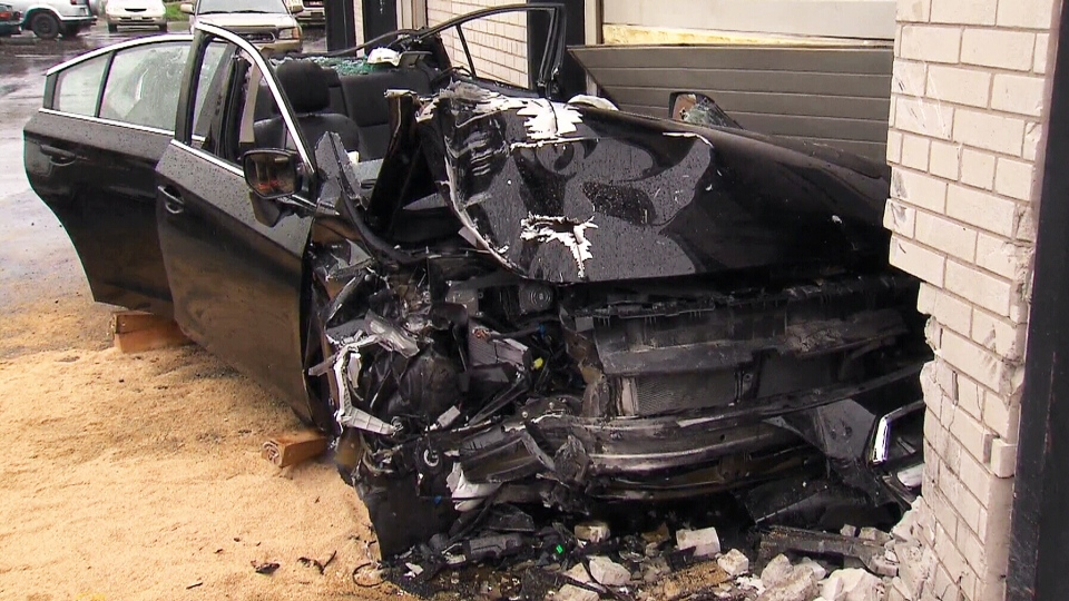 This photo shows the car after it crashed into the auto repair shop on May 31.