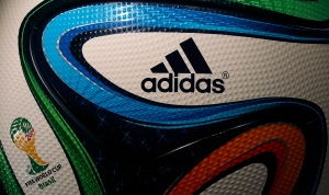 This May 8, 2014 file photo shows the Adidas logo on a FIFA World Cup soccer ball during the annual shareholders meeting in Fuerth, Germany. (AP / Matthias Schrader)