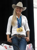 Olympic gold medallist Kaillie Humphries turned in her bobsled helmet for a stetson as she was named Calgary Stampede parade marshal in Calgary, Wednesday, June 3, 2015. (Bill Graveland / THE CANADIAN PRESS)