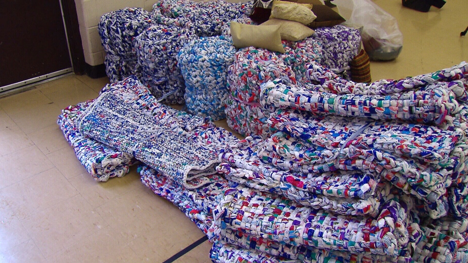 From Milk Bags To Mattresses Volunteers Weave Mats For A