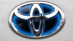 A Toyota logo is shown on a Prius in Wilsonville, Ore., on March 30, 2011. (AP / Rick Bowmer)