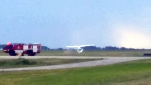 A plane makes an emergency landing after colliding with another plane near Fort McMurray, Alta., Sunday, June 21, 2015. (NARDOCREW / YouTube)