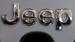 A Jeep logo on the grill of a Jeep Wrangler. (AP / Gene J. Puskar)