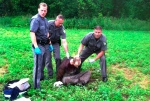 Police stand over David Sweat after he was shot and captured near the Canadian border on June 28, 2015, in Constable, N.Y. (AP Photo)