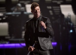 Robin Thicke performs during a tribute to Smokey Robinson at the BET Awards at the Microsoft Theater on Sunday, June 28, 2015, in Los Angeles. (Chris Pizzello/Invision)