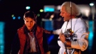 This photo released by Universal Pictures shows Michael J. Fox, left, as Marty McFly, and Christopher Lloyd as Dr. Emmett Brown, in a scene from the 1985 film, 'Back to the Future.' (Universal Pictures via AP)