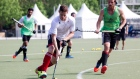 Scott Tupper controls the ball as players from Canada's Toronto 2015 Pan American Games men's field hockey team take part in a training session in Toronto on Wednesday April 27, 2015. THE CANADIAN PRESS/Chris Young