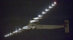 The Solar Impulse 2 flies over Nagoya Airport after taking off in Toyoyama, near Nagoya, central Japan, early Monday, June 29, 2015. (Kyodo News via AP)