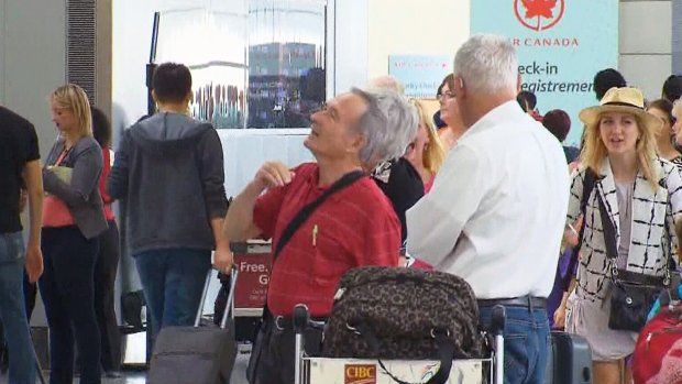 Delayed passengers wait at Pearson Airport in Toronto on Friday, July 3, 2015.