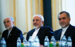 Iranian Foreign Minister Mohammad Javad Zarif, centre, Head of the Iranian Atomic Energy Organization Ali Akbar Salehi, left, and Hossein Fereydoon, brother and close aide to President Hassan Rouhani, meet with U.S. Secretary of State John Kerry in Vienna, Austria, Friday July 3, 2015. (Carlos Barria / Pool via AP)