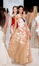 In this file photo, 2013 Miss Universe contestant Carolina Brid, of Panama, is shown at Fashion Week in Moscow, Russia on Oct. 26, 2013. (AP / Ivan Sekretarev)