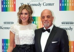 In this Dec. 7, 2013 file photo, Kennedy Center Honoree Billy Joel,right, and Alexis Roderick arrive at the Kennedy Center Honors gala dinner in Washington. (AP/Kevin Wolf, File)